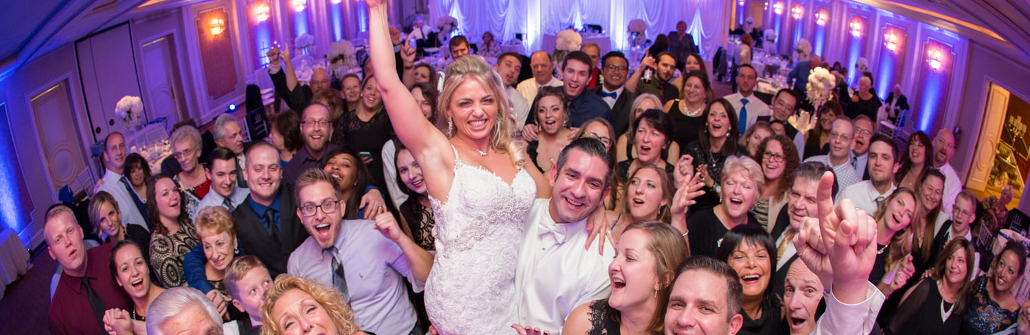Happy wedding guests on the dance floor in Astoria Banquets