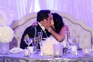 Astoria Banquets, Wedding Venue, Best of Banquets Halls, Wedding Wire, Knot, Event Space, Chicago and Suburbs, sweetheart table, happy couple kissing