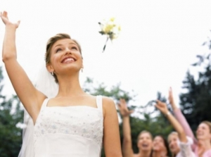 bride tossing up her bouquet