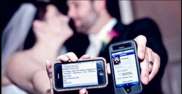 Guests Interacting With Each Other Via Social Media During A Wedding